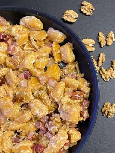 Gnocchi di zucca con fontina, speck e noci